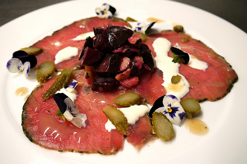Carpaccio of Welsh Beef Fillet, hazelnut and beetroot tartare, citrus dressing and horseradish cream